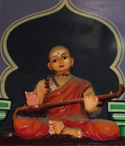 Mutthuswamy Dikshitar's idol  on the walls of the temple.